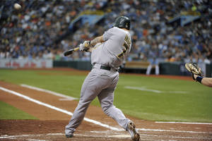 Photo -   Oakland Athletics' Brandon Inge swings on a three-run home run off of Tampa Bay Rays starting pitcher Matt Moore during the third inning of a baseball game Sunday, May 6, 2012, in St. Petersburg, Fla. (AP Photo/Brian Blanco)
