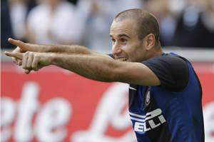Photo -   Inter Milan forward Rodrigo Palacio, of Argentina, celebrates after scoring during a Serie A soccer match between Inter Milan and Catania, at the San Siro stadium in Milan, Italy, Sunday, Oct.21, 2012. (AP Photo/Luca Bruno)
