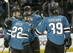 Photo - San Jose Sharks defenseman Dan Boyle (22) celebrates his goal with defenseman Matt Irwin, left, and Logan Couture (39) after scoring against the Edmonton Oilers during the first period of an NHL hockey game Tuesday, April 1, 2014, in San Jose, Calif. (AP Photo/Tony Avelar)