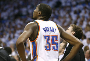 Photo - Oklahoma City's Kevin Durant (35) watches the replay of the last shot of overtime play during Game 5 in the first round of the NBA playoffs between the Oklahoma City Thunder and the Memphis Grizzlies at Chesapeake Energy Arena in Oklahoma City, Tuesday, April 29, 2014. Photo by Sarah Phipps, The Oklahoman