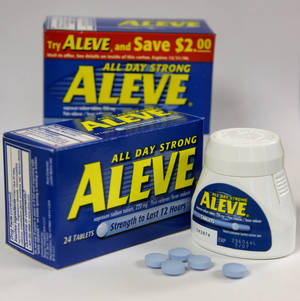 Photo - FILE - In this Tuesday, Dec. 21, 2004, file photo, several Aleve tablets appear in front of bottles of the pain reliever, in Boston.  Federal health experts are taking a second look this week at the heart safety of pain medications used by millions of Americans to treat arthritis and other everyday aches and pains. (AP Photo/Steven Senne, File)