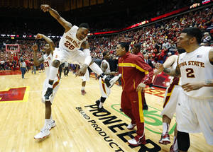 photo - Iowa State guard Will Clyburn 921) and Tyrus McGee (25) celebrate as guard Chris Babb (2) moves to join following their 73-67 win over Kansas State in an NCAA college basketball game, Saturday, Jan. 26, 2013, in Ames, Iowa. (AP Photo/Matthew Putney)