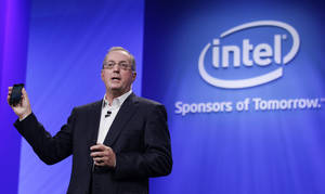 Photo - FILE - In this Tuesday, Sept. 13, 2011.Intel CEO Paul Otellini, holds up a Google Android phone running on an Intel chip during the keynote address at the Intel Developer Forum in San Francisco. Intel said Thursday, May 2, 2013, that it has chosen Brian Krzanich, as its new CEO. Krzanich, who is 52, will replace Otellini on May 16, at the company's annual meeting. Otellini had announced his decision to resign in November. Otellini, 62, will be ending a nearly 40-year career with Intel, including an eight-year stint as CEO by the time he leaves. (AP Photo/Paul Sakuma)