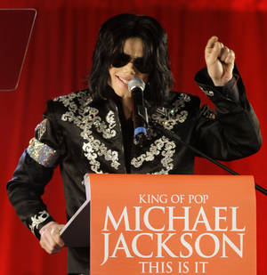 In this March 5, 2009 file photo, Michael Jackson announces several concerts at the London O2 Arena in July, at a press conference at the London O2 Arena. Emails displayed in a Los Angeles courtroom on Wednesday, May 22, 2013, show that a lawyer for AEG Live LLC's parent company described Jackson as a freak in an email message on the same day the singer signed a multimillion dollar contract to perform a series of comeback concerts in 2009. (AP Photo/Joel Ryan, file)