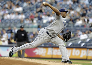 Photo - Tampa Bay Rays' Roberto Hernandez delivers a pitch during the first inning of a baseball game against the New York Yankees, Friday, June 21, 2013, in New York. (AP Photo/Frank Franklin II)