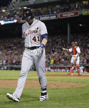 Photo - Detroit Tigers' Victor Martinez walks to the dugout after striking out in the eighth inning during Game 6 of the American League baseball championship series against the Boston Red Sox on Saturday, Oct. 19, 2013, in Boston. The Red Sox won 5-2 to advance to the World Series. (AP Photo/Matt Slocum)
