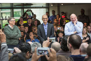 Photo -  Satya Nadella, Microsoft's new CEO, addresses employees along with Bill Gates and Steve Ballmer on the company's Redmond, Wash., campus. PRNewsFoto  <strong></strong>