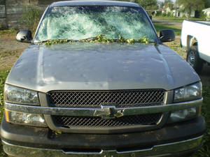 Photo - Grandfield City Manager Randy Clark's pickup was smashed by baseball-size hail during a surprise storm Friday. PHOTO PROVIDED