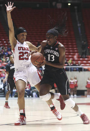 Photo - Stanford's Chiney Ogwumike (13) drives to the basket as Utah's Ariel Reynolds (23) defends during the first half of an NCAA college basketball game Friday, Jan. 10, 2014, in Salt Lake City. (AP Photo/Kim Raff)