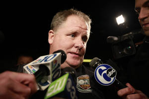 photo - Chip Kelly speaks to members of the media as he arrives at Northeast Philadelphia Airport, Wednesday, Jan. 16, 2013, in Philadelphia. Oregon's enigmatic NCAA college football head coach of four years surprised the school with an early morning phone call Wednesday to say he was leaving to become head coach of the Philadelphia Eagles NFL football team, just a little more than a week after he told Oregon he was staying. (AP Photo/The Philadelphia Inquirer, David Swanson)  PHIX OUT; TV OUT; MAGS OUT; NEWARK OUT