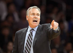 Photo - FILE - In this Feb. 28, 2014, file photo, Los Angeles Lakers head coach Mike D'Antoni gestures during the second half of an NBA basketball game against the Sacramento Kings in Los Angeles. Lakers spokesman John Black confirmed D'Antoni's resignation Wednesday, April 30. (AP Photo/Mark J. Terrill, File)