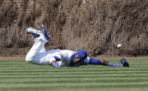 Photo - Chicago Cubs left fielder Junior Lake can' t make the catch on a double hit by Cincinnati Reds' Billy Hamilton during the fifth inning of a baseball game in Chicago, Friday, April  18, 2014. (AP Photo/Nam Y. Huh)