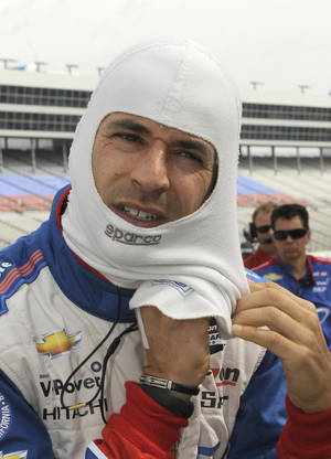 Photo - Helio Castroneves, of Brazil, prepares for IndyCar auto racing practice at Texas Motor Speedway in Fort Worth, Friday, June 6, 2014. (AP Photo/Larry Papke)