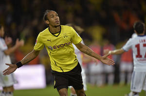 Photo - Dortmund's Pierre-Emerick Aubameyang celebrates his second goal during the German soccer Bundesliga match between Borussia Dortmund and Hamburger SV in Dortmund, Germany, Saturday, Sept. 14, 2013.  (AP Photo/Martin Meissner)