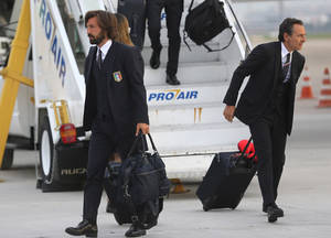 Photo - Italy's player Andrea Pirlo, left, and coach Cesare Prandelli deplane at Galeao Air Base as they arrive for the World Cup in Rio de Janeiro, Brazil, Friday, June 6, 2014. The Italian team will be based at a resort in Mangaratiba during the soccer international tournament.  (AP Photo/Leo Correa)