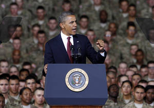 Photo -   President Barack Obama speaks to troops, service-members and military families at the 1st Aviation Support Battalion Hangar at Fort Bliss, Friday, Aug. 31, 2012, in El Paso, Texas. (AP Photo/Tony Gutierrez)