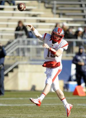 Photo - CORRECTS ID TO CHAS DODD (19), NOT DEVIN RAY (15) - Rutgers quarterback Chas Dodd (19) passes during the first half of an NCAA college football game against  Connecticut, in East Hartford, Conn., on Saturday, Nov. 30, 2013. (AP Photo/Fred Beckham)