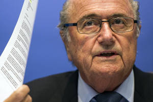 Photo - FIFA President Sepp Blatter speaks to journalists following the FIFA Executive Committee meeting in Zurich, Switzerland, Friday, Oct. 4, 2013. Blatter said a final decision on which months to play the 2022 World Cup in Qatar might be delayed until 2015. (AP Photo/Keystone, Ennio Leanza)