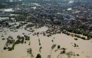 Photo - A flooded area is seen in Obrenovac, some 30 kilometers (18 miles) southwest of Belgrade, Serbia, Monday, May 19, 2014. Belgrade braced for a river surge Monday that threatened to inundate Serbia's main power plant and cause major power cuts in the crisis-stricken country as the Balkans struggle with the consequences of the worst flooding in southeastern Europe in more than a century. At least 35 people have died in Serbia and Bosnia in the five days of flooding caused by unprecedented torrential rain, laying waste to entire towns and villages and sending tens of thousands of people out of their homes, authorities said. (AP Photo)
