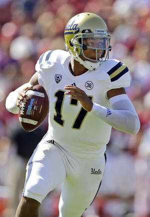 Photo - UCLA quarterback Brett Hundley (17) during runs out of the pocket in the first half of an NCAA college football game against Stanford on Saturday, Oct. 19, 2013, in Stanford, Calif. (AP Photo/Marcio Jose Sanchez)