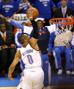 Photo - Oklahoma City's Russell Westbrook (0) goes up for a dunk during game 4 of the Western Conference Finals in the NBA basketball playoffs between the Dallas Mavericks and the Oklahoma City Thunder at the Oklahoma City Arena in downtown Oklahoma City, Monday, May 23, 2011. Photo by Bryan Terry, The Oklahoman