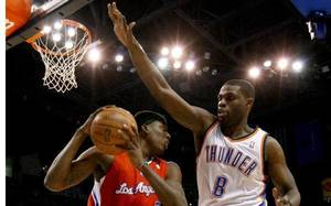 photo - Oklahoma City&#039;s Nazr Mohammed (8) defends Los Angeles Clippers&#039; Brian Cook (3) during the NBA basketball game between the Oklahoma City Thunder and the Los Angeles at the Oklahoma City Arena, Wednesday, April 6, 2011. Photo by Bryan Terry, The Oklahoman &lt;strong&gt;BRYAN TERRY&lt;/strong&gt;