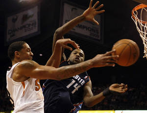 Photo - Charlotte Bobcats small forward Michael Kidd-Gilchrist (14) fouls Phoenix Suns power forward Channing Frye (8) in the third quarter during an NBA basketball game on Saturday, Feb. 1, 2014, in Phoenix. (AP Photo/Rick Scuteri)