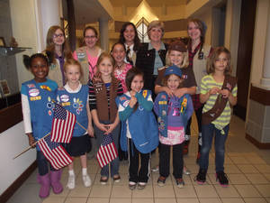 Photo -  A group of Girl Scouts tours city hall with Norman Mayor Cindy Rosenthal, back row, second from left. PHOTO PROVIDED <strong></strong>