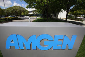 Photo - FILE - This April 20, 2010, file photo shows an exterior view of Amgen offices in Fremont, Calif. Drugmaker Amgen Inc. on Wednesday, Jan. 23, 2013 posted a 16 percent drop in fourth-quarter profit, as higher costs for production, marketing, research and other items offset higher sales for many of its biologic medicines. The results fell a bit short of Wall Street expectations. (AP Photo/Paul Sakuma, File)