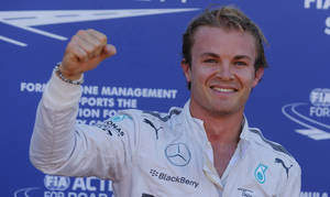 Photo - Mercedes driver Nico Rosberg of Germany celebrates after setting the pole position in the qualifying session at the Monaco racetrack, in Monaco, Saturday, May 24, 2014. Nico Rosberg has taken pole position for the Monaco Grand Prix ahead of his Mercedes teammate Lewis Hamilton and Red Bull's Daniel Ricciardo. The Monaco Formula One Grand Prix will be held on Sunday. (AP Photo/Luca Bruno)