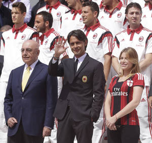 Photo - AC Milan coach Filippo Inzaghi, center, poses flanked by AC Milan vice president Barbara Berlusconi, right, and vice president Adriano Galliani during the presentation of the upcoming 2014-15 season at the AC Milan headquarter in Milan, Italy, Thursday, July 10, 2014. (AP Photo/Luca Bruno)
