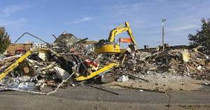 Photo - A building that has stood on the busy corner of 33rd Street and Broadway has been demolished. The 7,395-square-foot building has been the home of several restaurants. Kabuki Steak and Sushi Bar was the last restaurant to operate in the building.   PHOTO BY DIANA BALDWIN, THE OKLAHOMAN