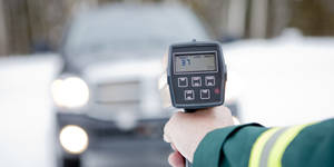 Photo - Canada, Alberta, Traffic officer holding speed gun