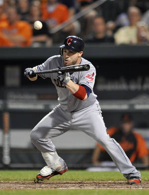 Photo -   Cleveland Indians Jason Kipnis bunts for a single against the Baltimore Orioles during the sixth inning of a baseball game on Friday, June 29, 2012 in Baltimore. The Orioles won 9-8. (AP Photo/Gail Burton)