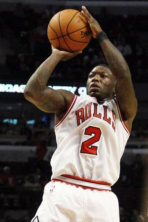 photo -   Chicago Bulls guard Nate Robinson shoots during the second half of an NBA preseason basketball game against the Milwaukee Bucks, Tuesday, Oct. 16, 2012, in Chicago. The Bulls won 100-94. (AP Photo/Charles Rex Arbogast)