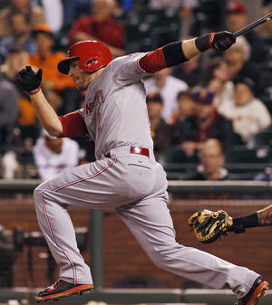 Photo - Cincinnati Reds' Zack Cozart hits a two RBI single to put the Reds ahead of the San Francisco Giants during the eleventh inning of a baseball game, Saturday, June 28, 2014, in San Francisco.  (AP Photo/George Nikitin)