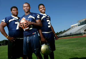 Photo - High school football players Markus Wakefield, Barry Sanders and Sterling Shepard (from left to right) pose at Heritage Hall High School, in Oklahoma City on Thursday, June 23, 2011. Photo by John Clanton, The Oklahoman ORG XMIT: KOD