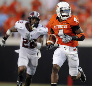 photo - Freshman Justin Gilbert (4) is who coaches think will be the next great return man at Oklahoma State. PHOTO BY NATE BILLINGS, THE OKLAHOMAN