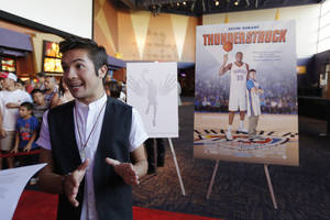 Photo - Actor Taylor Gray answers questions for an interview during the red carpet premiere of Thunderstruck at Harkins Bricktown Theatre in Oklahoma City, Sunday, Aug. 19, 2012.  Photo by Garett Fisbeck, For The Oklahoman