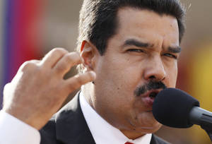 Photo - Venezuela's President Nicolas Maduro speaks during a military promotion ceremony at the 4F military museum in Caracas, Venezuela, Friday, July 5, 2013.  Venezuela marks on Friday the 202 anniversary of independence from Spain. (AP Photo/Ariana Cubillos)