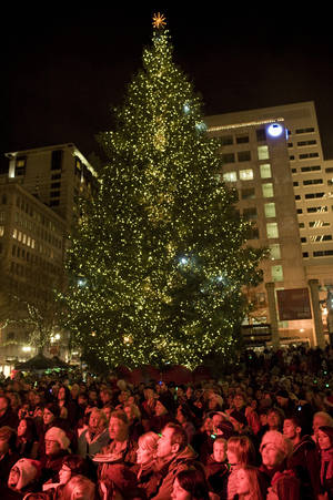 Photo - FILE - In this Nov. 26, 2010 file photo, a crowd watches as a Christmas tree is lit on Pioneer Courthouse square Friday night in Portland, Ore. where federal agents in a sting operation arrested a Somali-born teenager just as he tried blowing up a van full of what he believed were explosives at the crowded  ceremony.   Portland's fractious relationship with federal law enforcement was on full display during jury selection for the terrorism trial of the teenager. Prospective jurors repeatedly expressed reservations about the FBI's terrorism stings and the war on terror during approximately eight hours of questioning on Thursday, Jan. 10, 2013.(AP Photo/The Oregonian, Torsten Kjellstrand, File) MANDATORY CREDIT; MAGS OUT; NO SALES