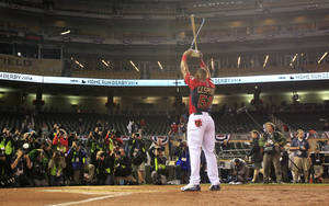 Photo - American League's Yoenis Cespedes, of the Oakland Athletics, holds the trophy after winning the MLB All-Star baseball Home Run Derby, Monday, July 14, 2014, in Minneapolis. Cespedes defeated National League's Todd Frazier, of the Cincinnati Reds, in the finals. (AP Photo/Jeff Roberson)