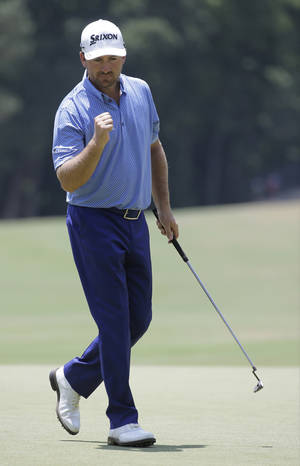 Photo - Graeme McDowell, of Northern Ireland, celebrates after a putt on the fourth hole during the third round of the U.S. Open golf tournament in Pinehurst, N.C., Saturday, June 14, 2014. (AP Photo/Eric Gay)