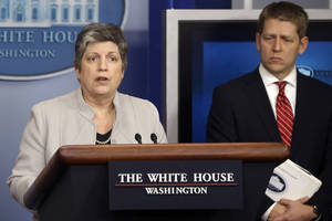 Photo - Homeland Security Secretary Janet Napolitano, accompanied by White House press secretary Jay Carney, briefs reporters on the sequester, Monday, Feb. 25, 2013, at the White House in Washington. (AP Photo/Charles Dharapak)