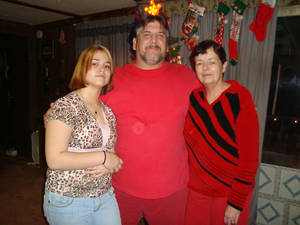Photo - Kaylee Famrough, 13, lost both parents - Susan Gail Fambrough, 54; and William Vincent Fambrough, 48 - to a tornado Tuesday night and barely escaped with her own life. This is the three of them celebrating Christmas last year. Photo provided.
