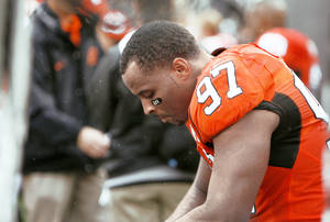 photo - OSU coach Mike Gundy hopes Jermiah Price and the rest of the Cowboys respond to last week's loss to  Houston with a win over Rice today. Photo by Sarah Phipps, The Oklahoman
