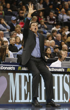 Photo - Houston Rockets head coach Kevin McHale calls a play against the Memphis Grizzlies in the first half of an NBA basketball game, Saturday, Jan. 25, 2014, in Memphis, Tenn. (AP Photo/Lance Murphey)