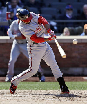 Photo - Washington Nationals' Anthony Rendon hits an RBI double during the seventh inning of a baseball game against the New York Mets on opening day at Citi Field in New York, Monday, March 31, 2014. (AP Photo/Seth Wenig)