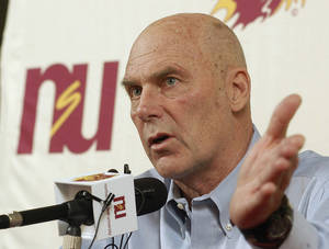 Photo - FILE - In this Feb. 27, 2010 file photo, Northern State coach Don Meyer addresses the media after an NCAA college basketball game in Aberdeen, S.D., where he announced he would be retiring. Meyer, one of the winningest coaches in college basketball who came back from a near-fatal car accident and liver cancer before closing out his career, has died in South Dakota. He was 69. (AP Photo/Doug Dreyer, File)