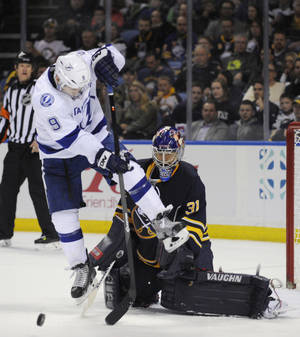 Photo - Tampa Bay Lightning center Tyler Johnson (9) gets ready to deflect the puck at Buffalo Sabres goaltender Matt Hackett (31) during the second period of an NHL hockey game in Buffalo, N.Y., Saturday, March 29, 2014. (AP Photo/Gary Wiepert)